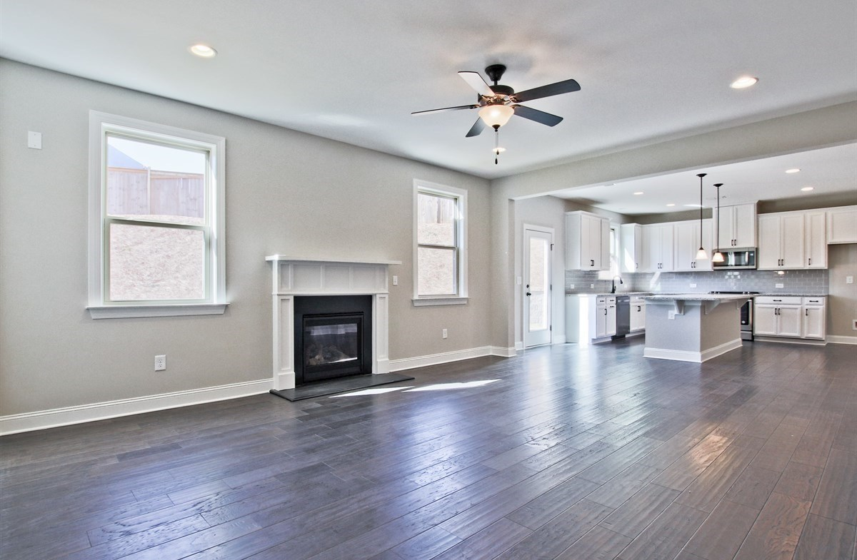 Manchester quick move-in Family room with fireplace