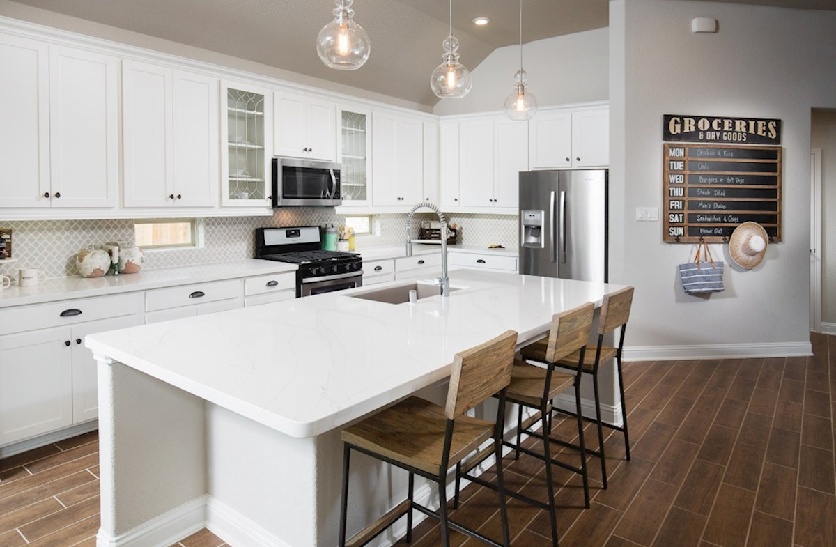 Bridgeland: Parkland Village Capri kitchen with stone counter and white cabinets