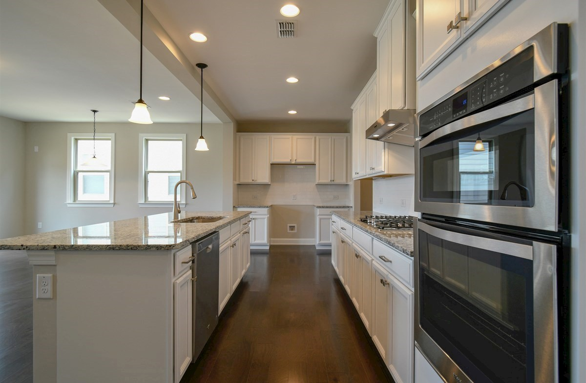 Aspen quick move-in Kitchen with stainless steel appliances