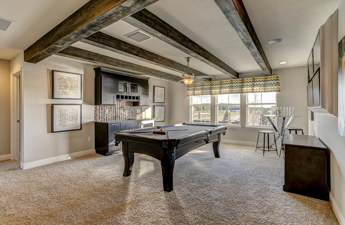 The Reserve at Pradera Sequoia Loft designed as a game room