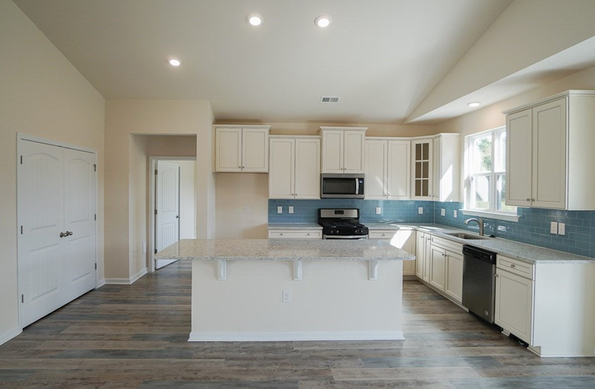 Georgetown quick move-in kitchen features tile backsplash and vaulted ceilings