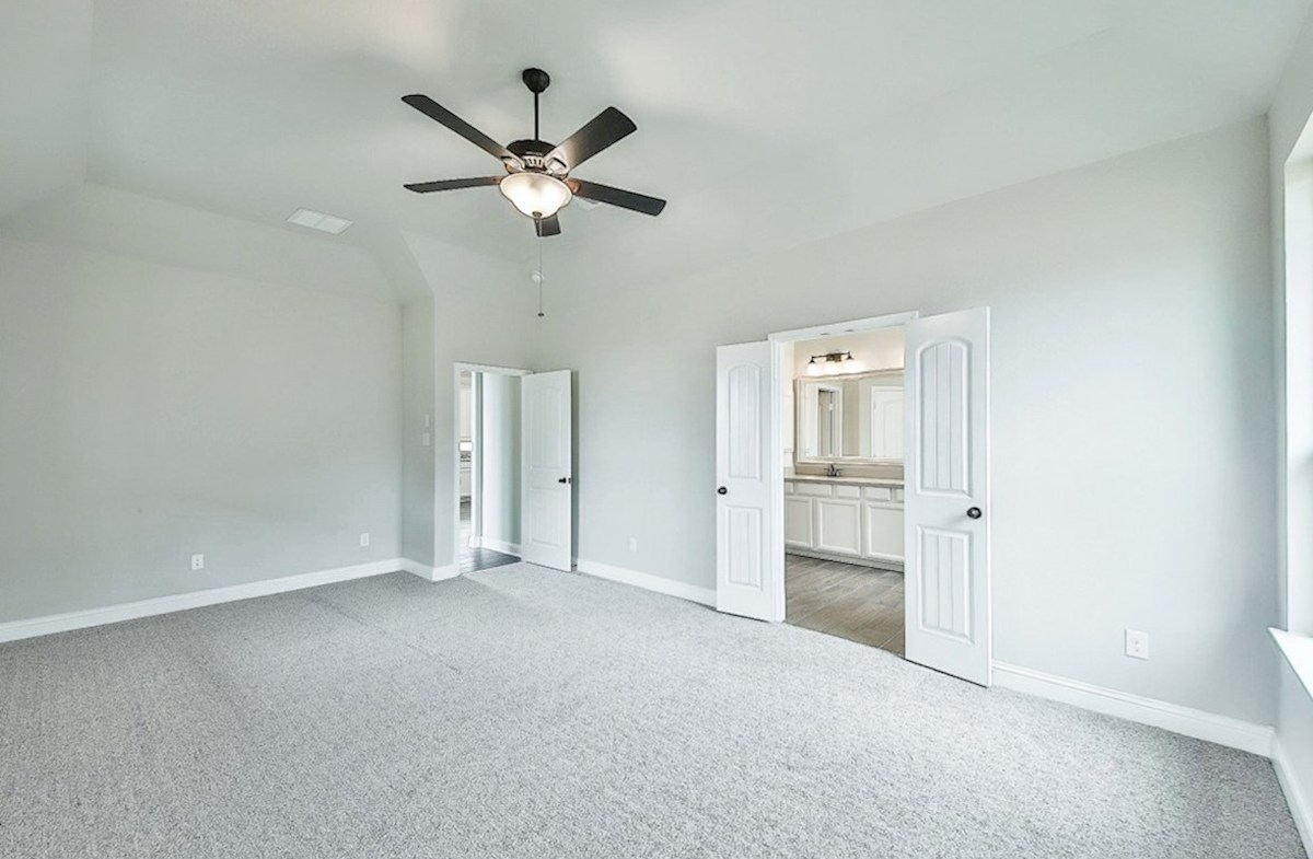 Capri quick move-in master bedroom with carpet and tall ceilings