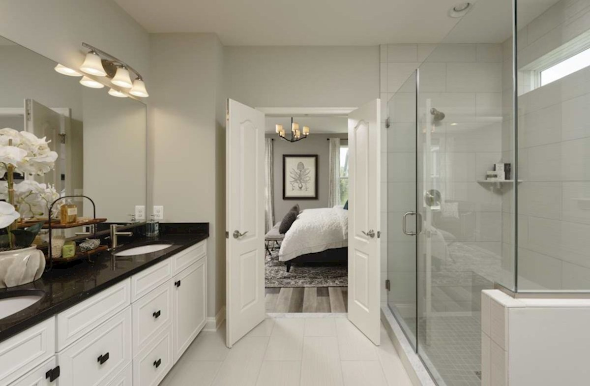 The Estuary Newport Spa-inspired master bath featuring dual vanities
