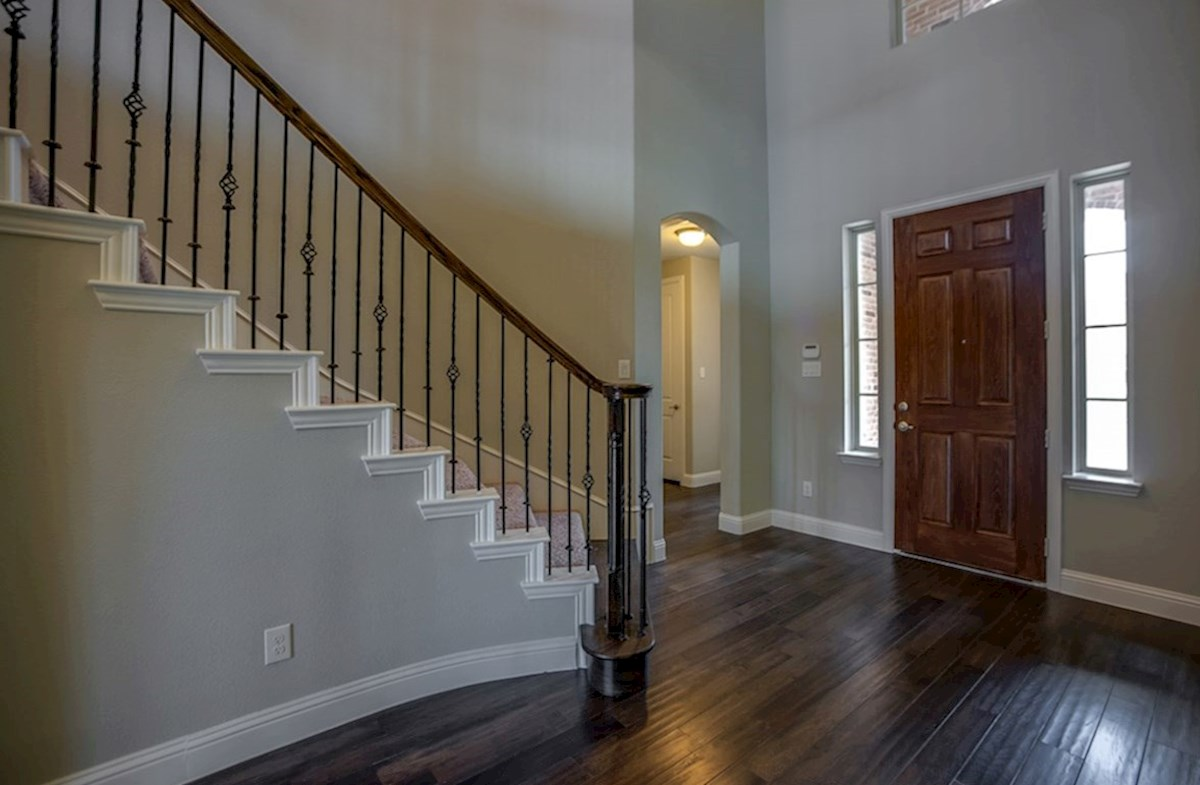 Trinity quick move-in entry with curved staircase and wrought iron spindles