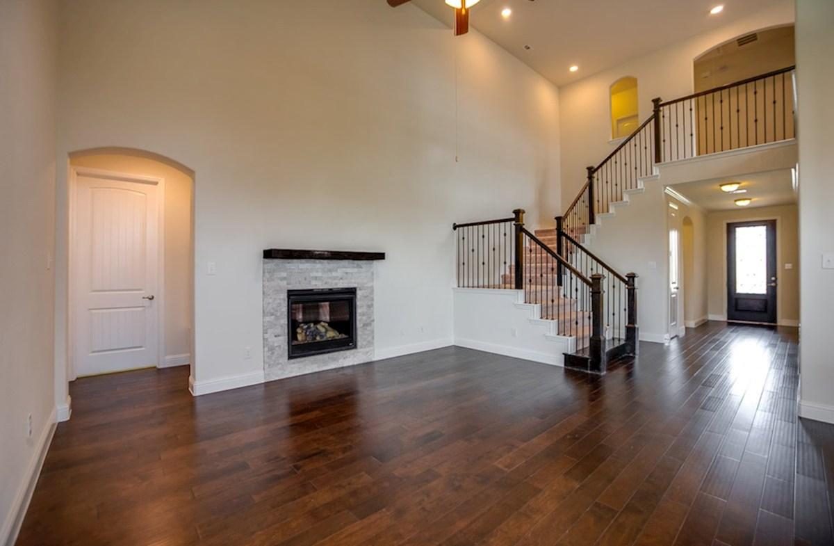 Richland quick move-in great room with wood flooring and fireplace