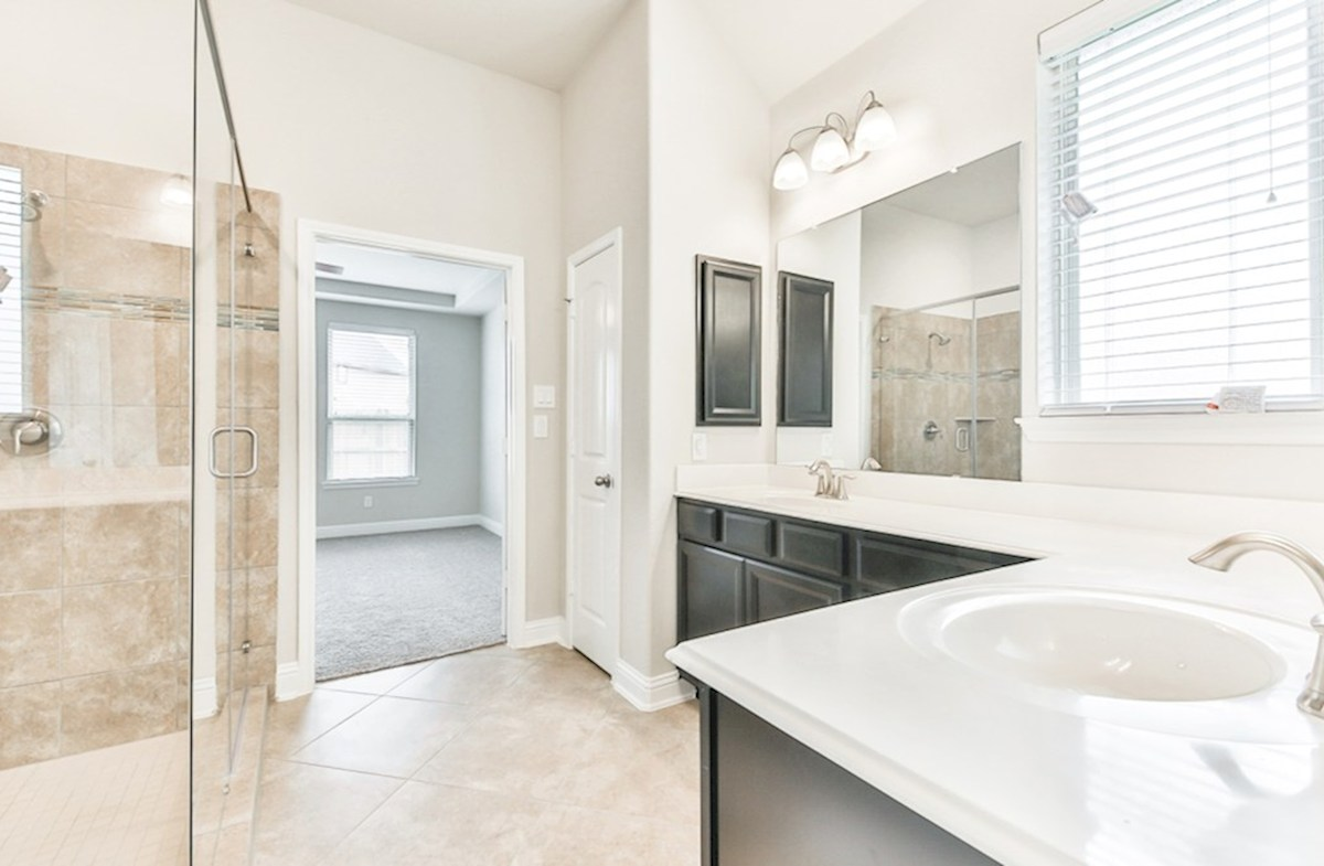 Cameron quick move-in master bathroom with dual vanities and super shower