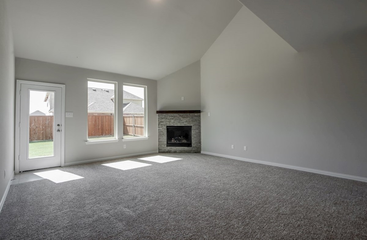 Prescott quick move-in great room with carpet and fireplace