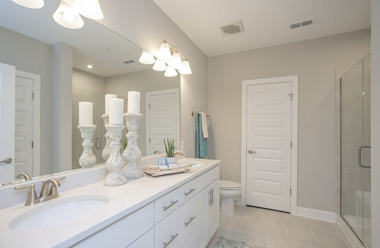 Sherwood primary bathroom with white cabinetry