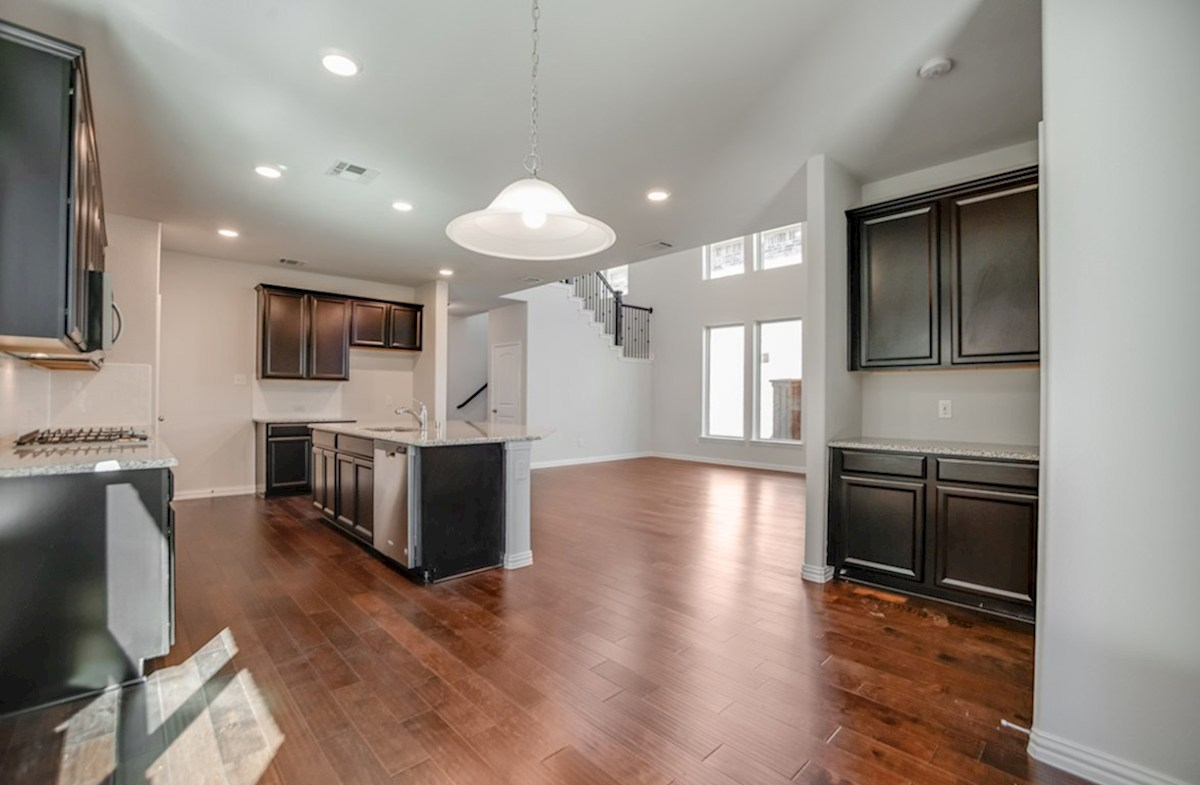 Whitney quick move-in open kitchen and breakfast nook with wood floors