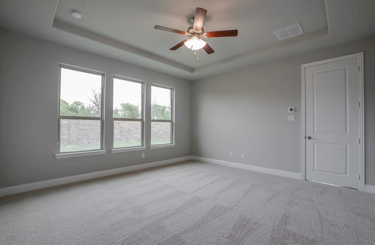 Summerfield quick move-in Summerfield master bedroom with tray ceiling