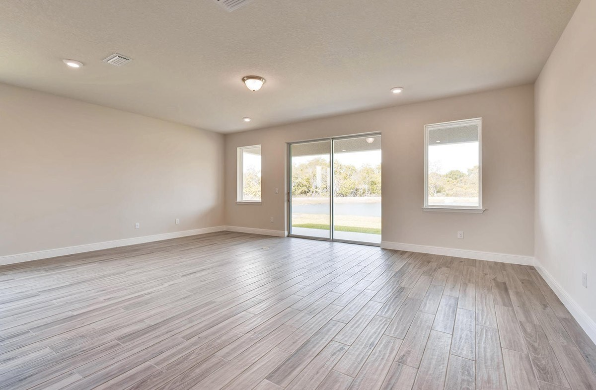 Bayview quick move-in Spacious great room with sliding glass doors and large windows