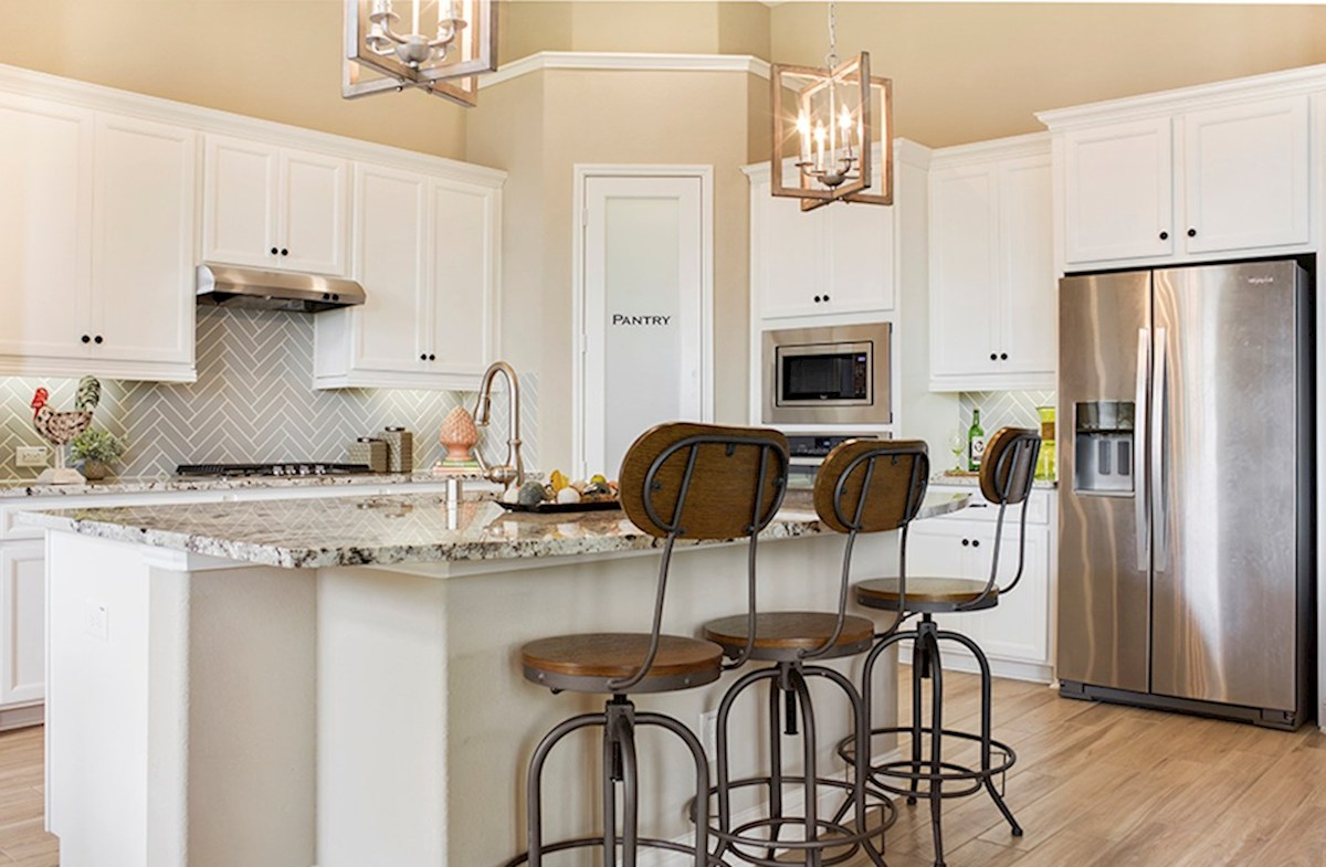 Bandera quick move-in kitchen with pendant lighting and granite countertops