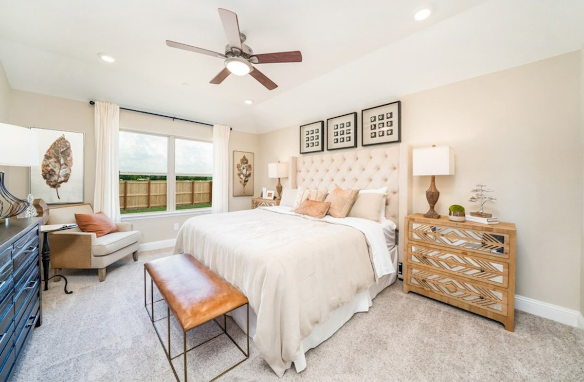 Amira  Maxwell master bedroom with ceiling fan and carpet flooring