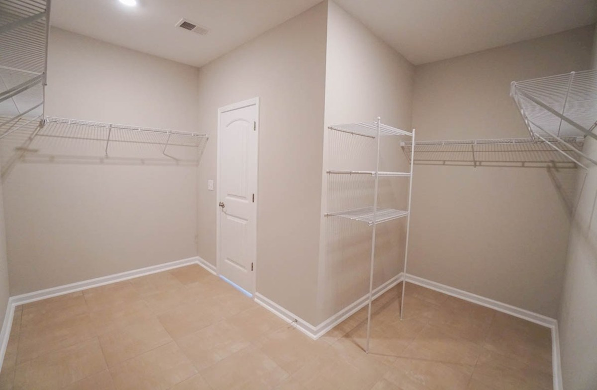 Belle Mer Graham master closet with pass through to laundry room
