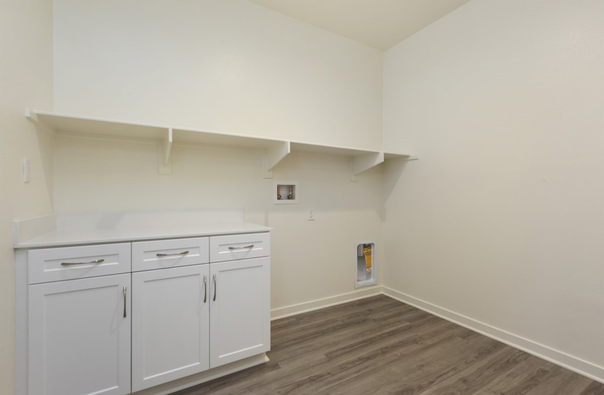 Piedmont quick move-in Oversized laundry room so you can fit an ironing board and optional cabinets or countertops