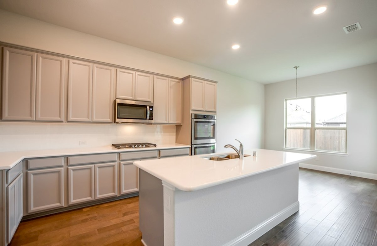 Blakely quick move-in open kitchen next to cozy breakfast nook with windows