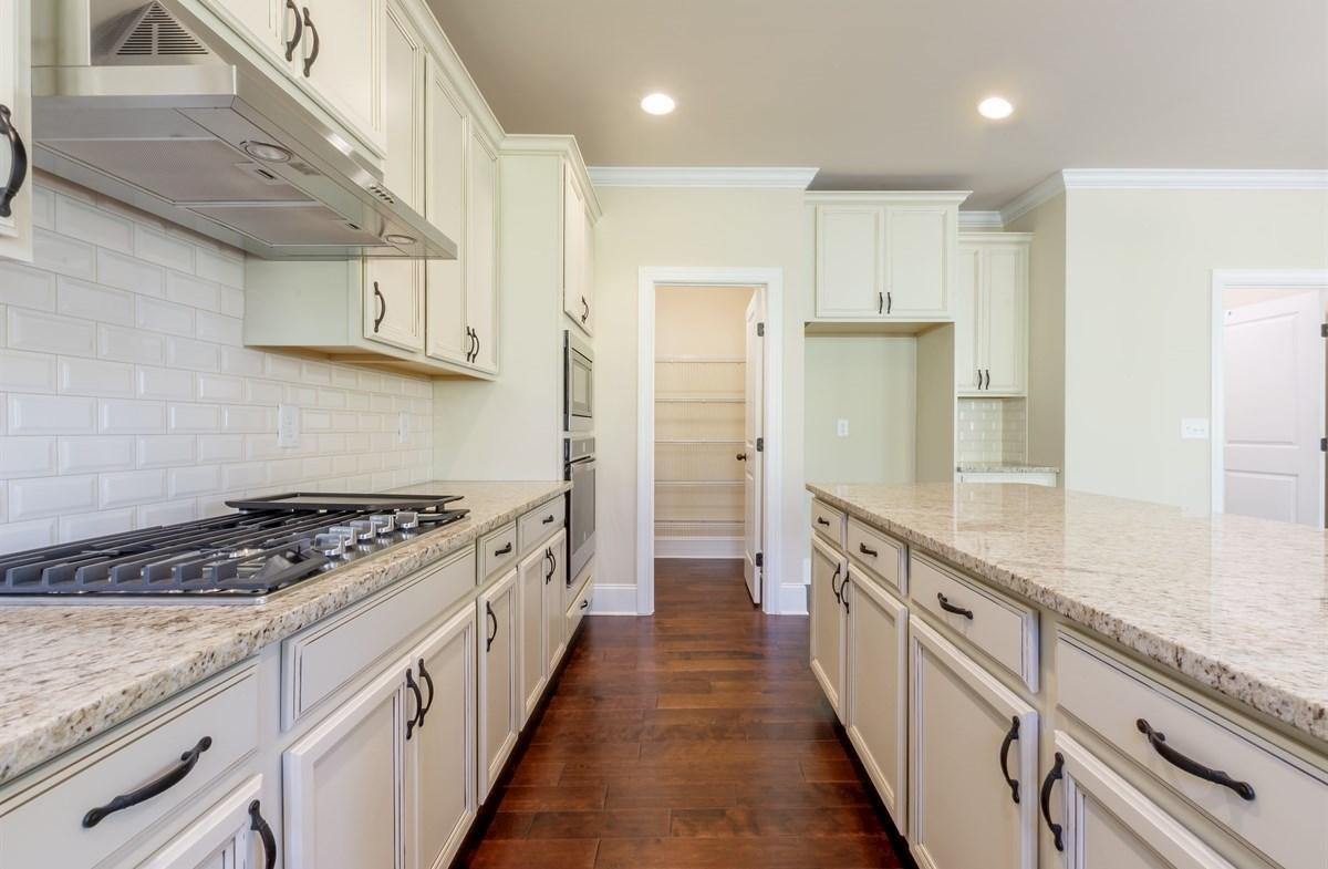 Stockton quick move-in Kitchen with granite countertops
