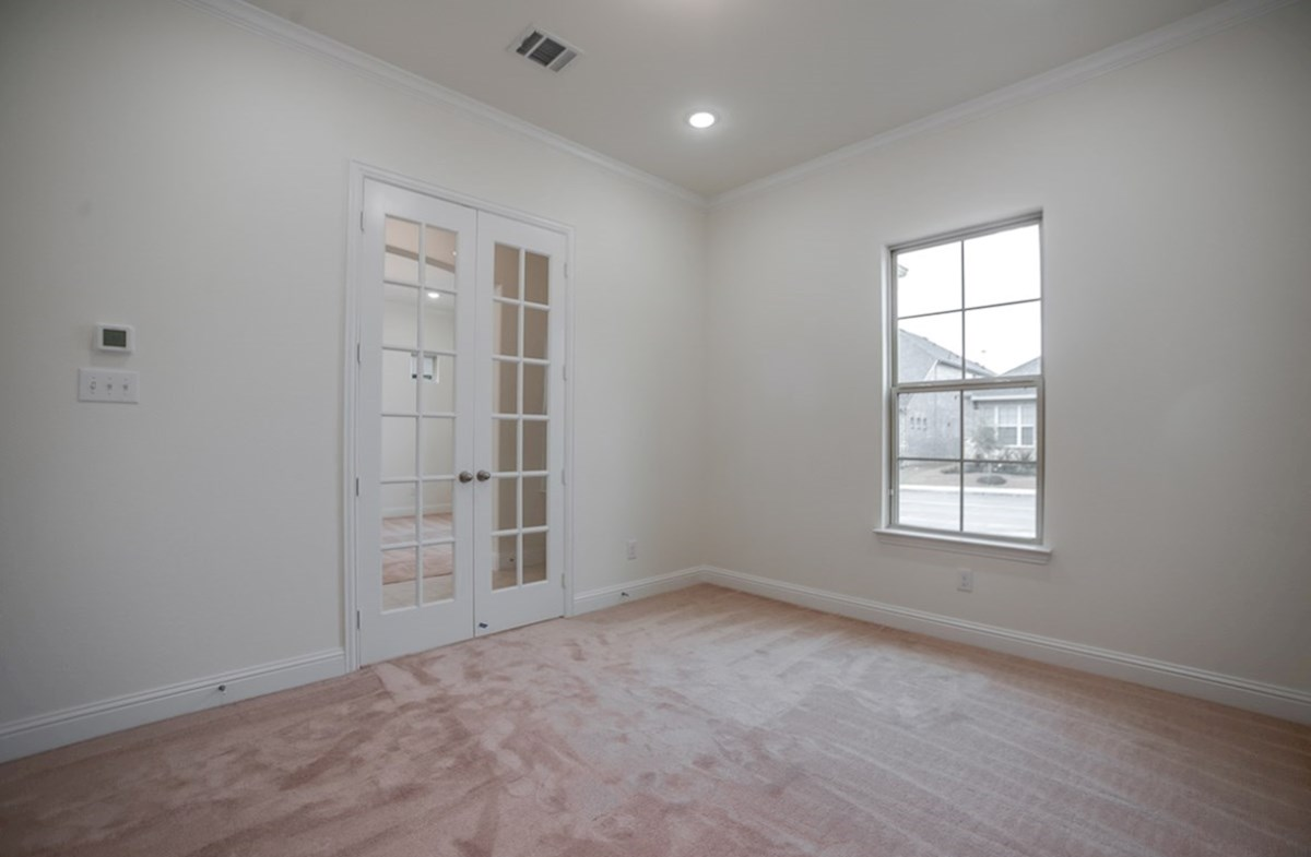 Whitney quick move-in study with French doors and carpet