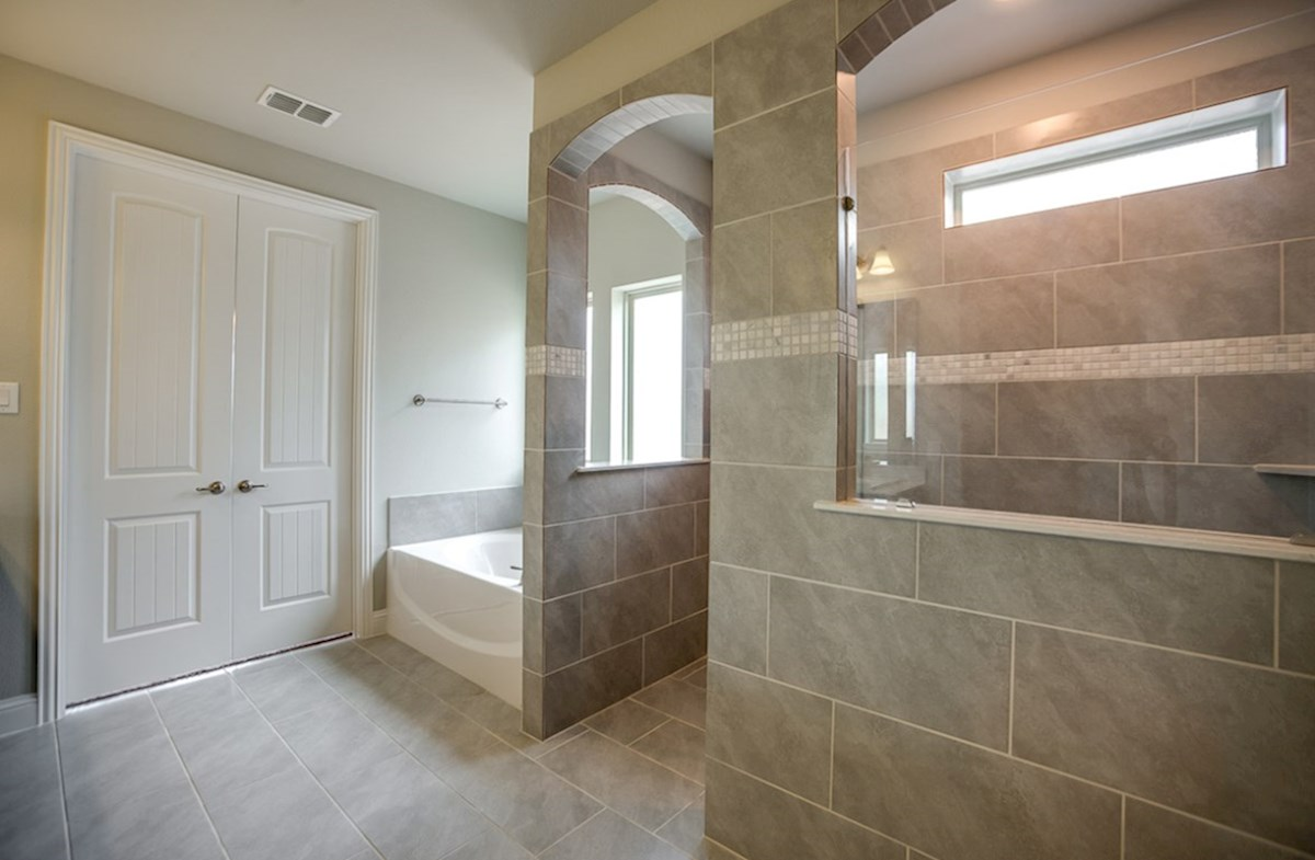 Trinity quick move-in master bath with tile surround throughout bath and shower