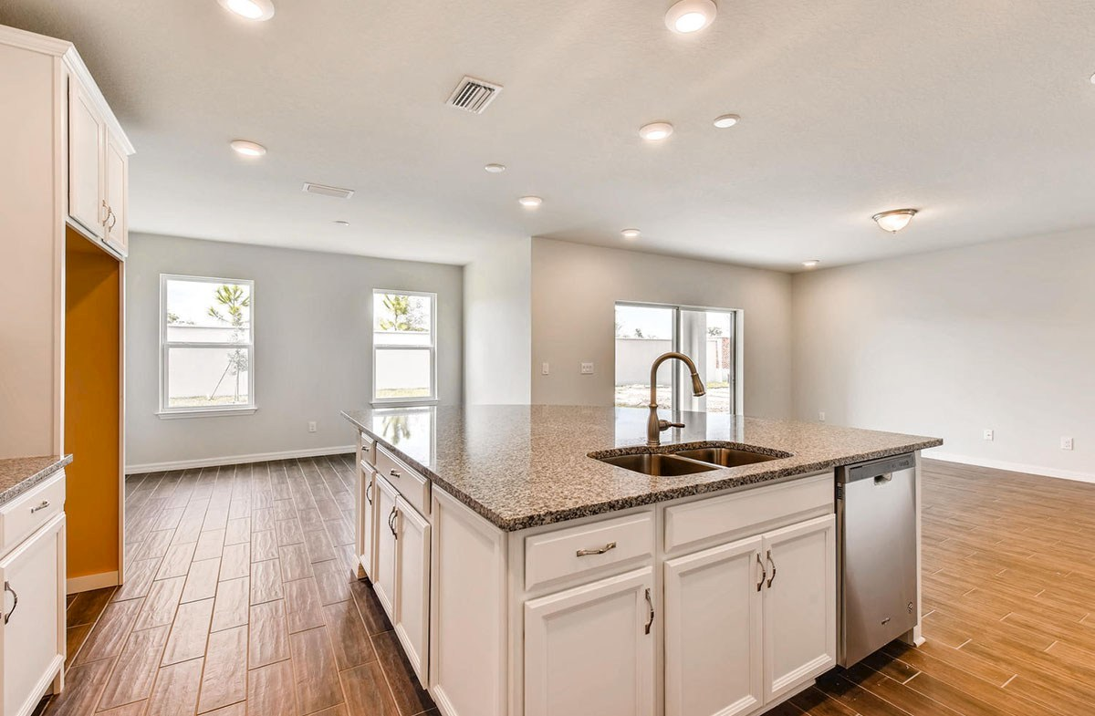 Cypress Pointe quick move-in Kitchen with large island opens to the great room