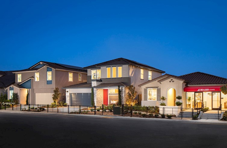 front exteriors of model homes at dusk