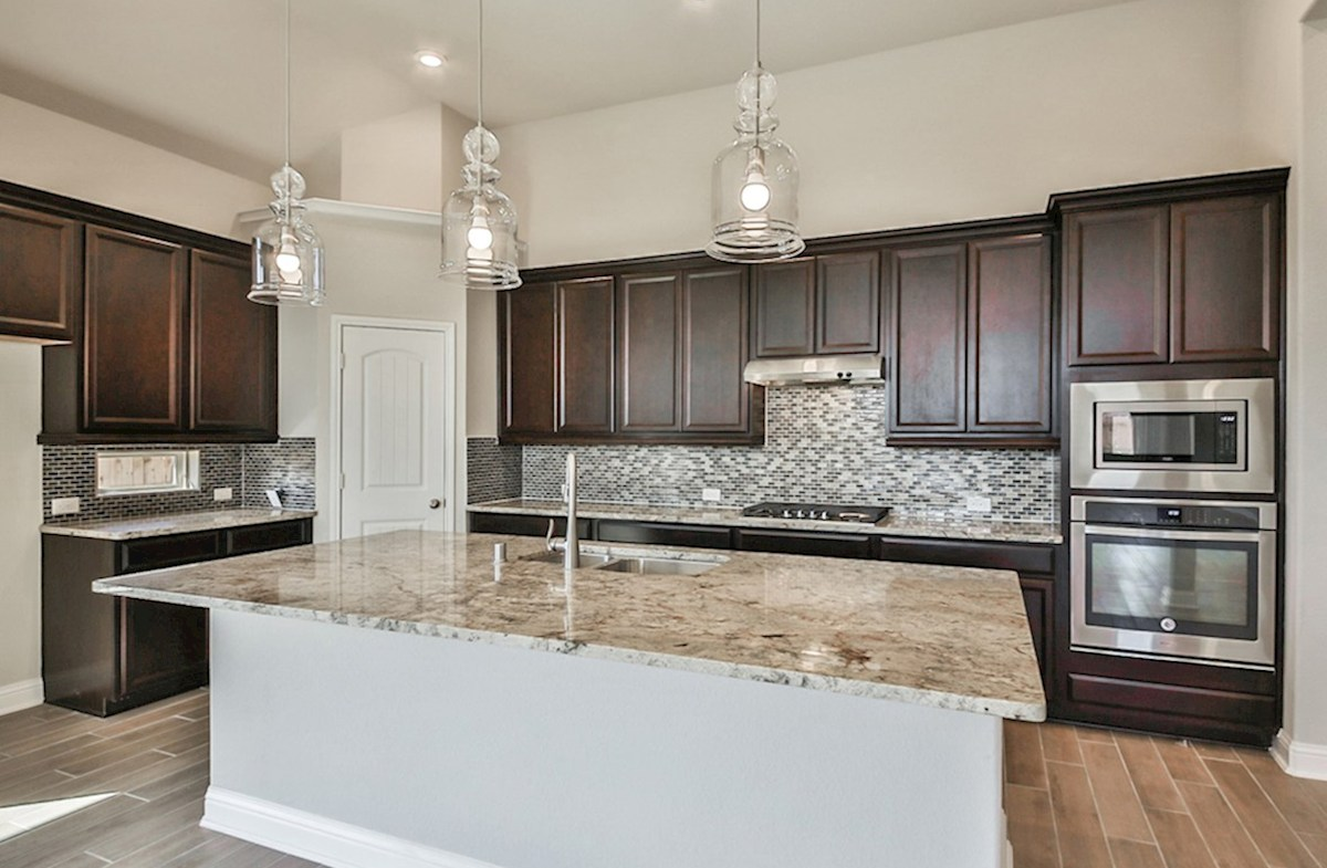Cameron quick move-in kitchen with granite countertops, tile flooring and stainless steel appliances