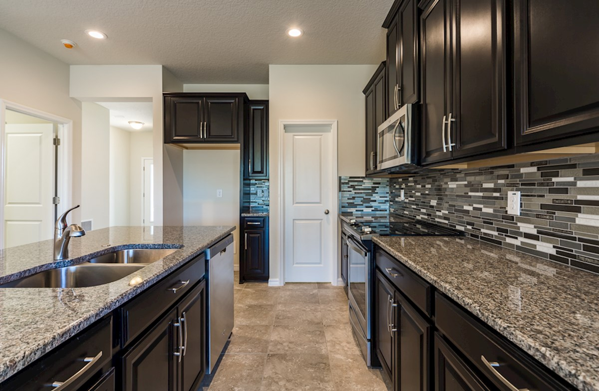 St Augustine II quick move-in Kitchen boasts large center island
