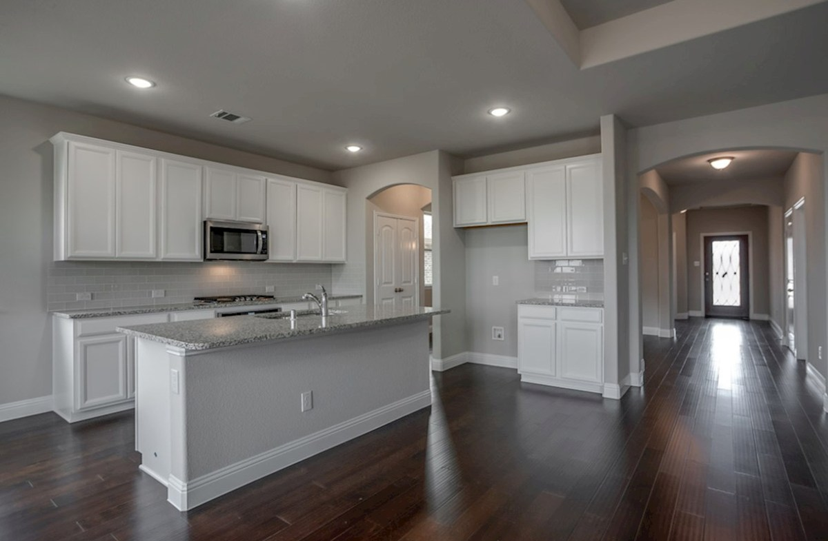 Avalon quick move-in kitchen features white cabinets and granite countertops