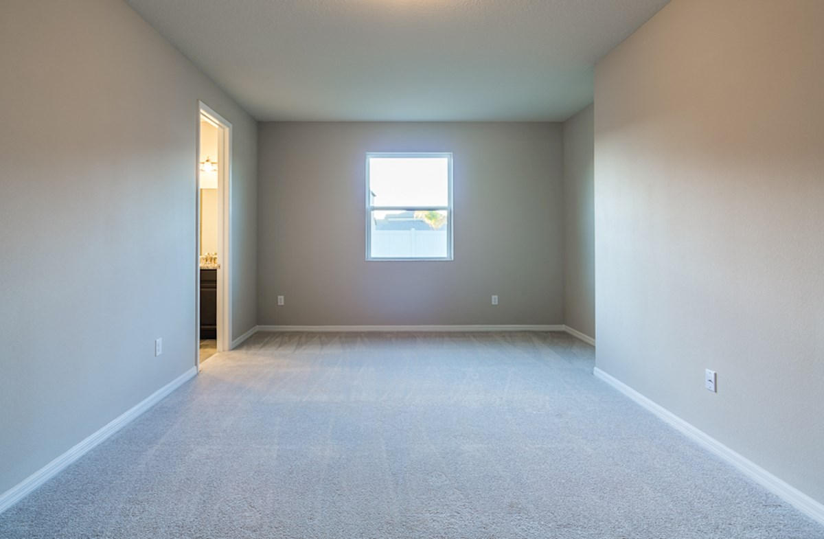 St. Augustine III quick move-in Large master bedroom boasts upgraded carpet