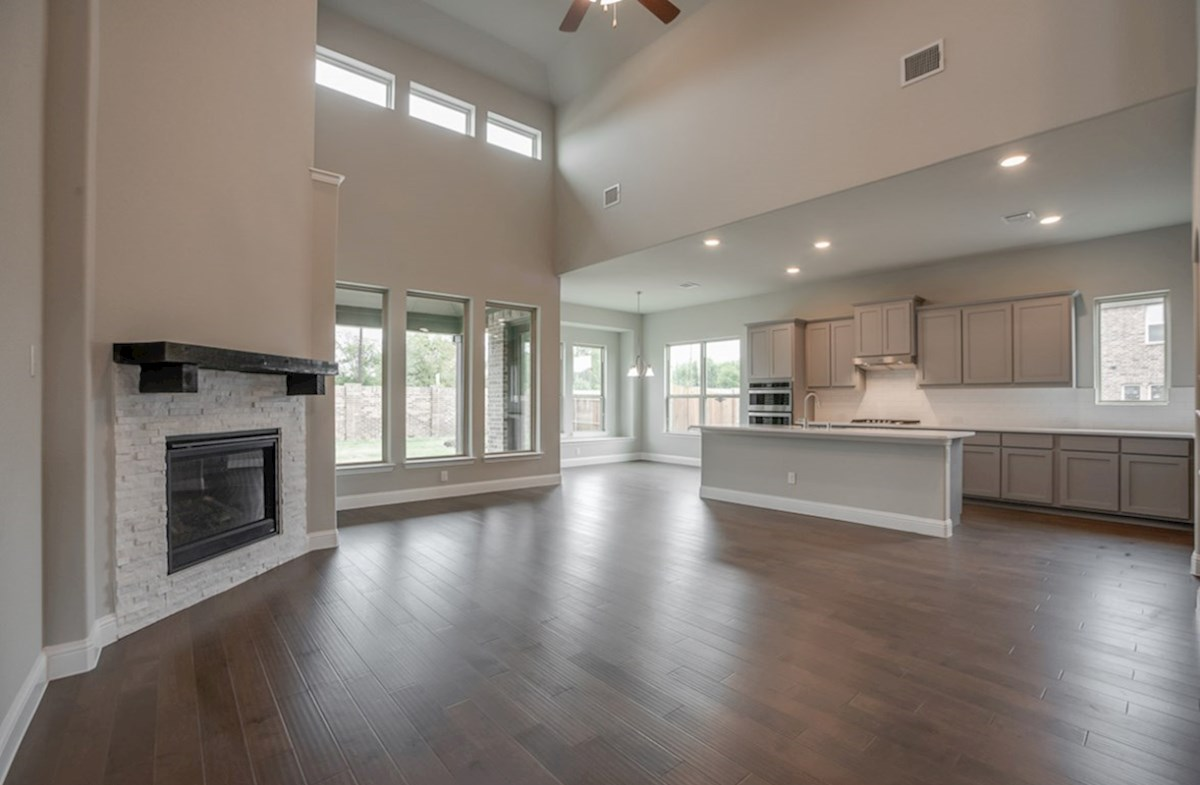 Summerfield quick move-in Summerfield great room with tall ceilings and fireplace