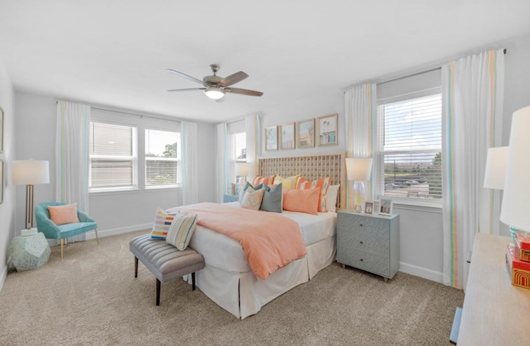 Sherwood primary bedroom with carpet floors and ceiling fan