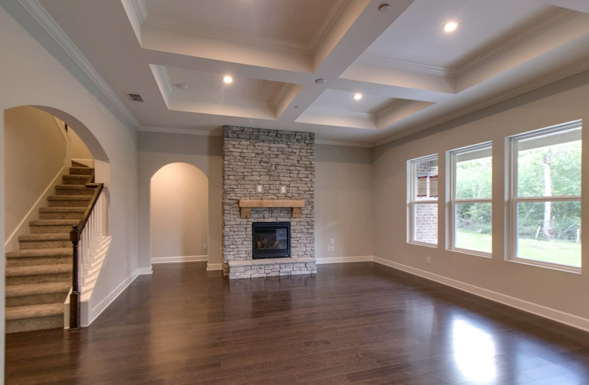 Mckinley quick move-in great room with stone fireplace and coffered ceiling