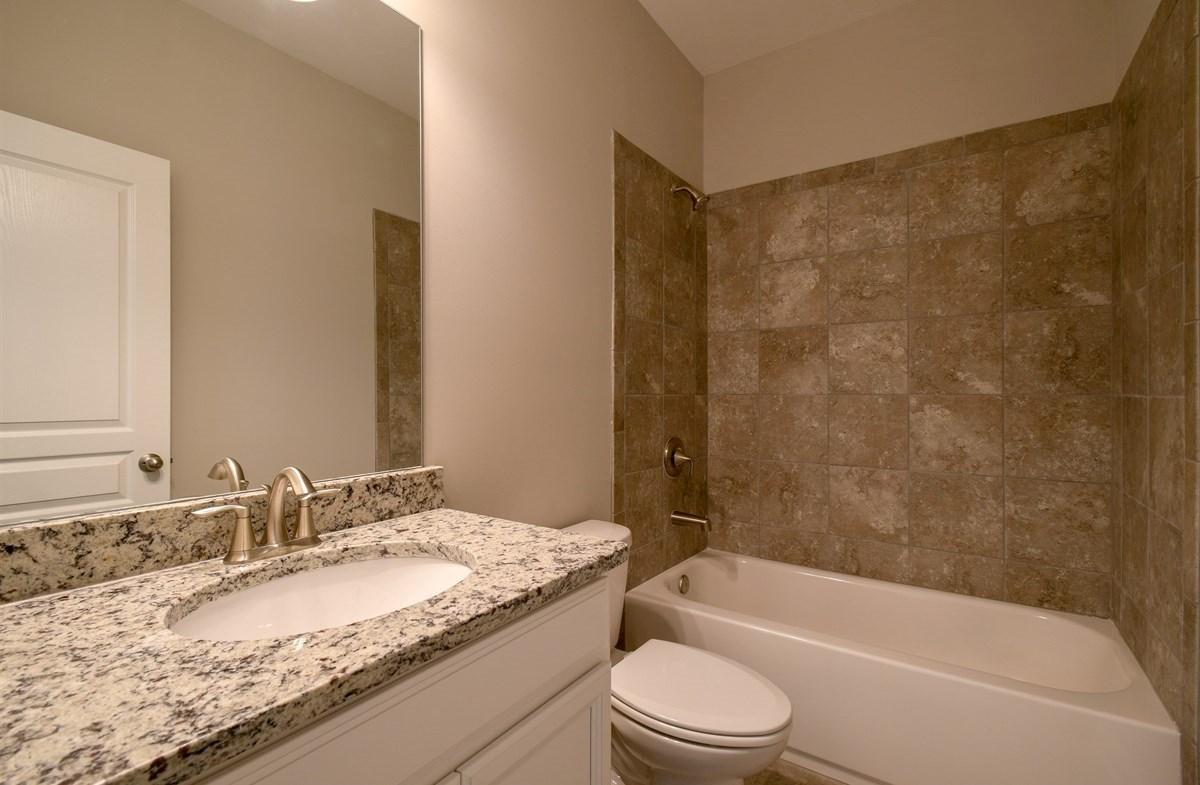 Aspen quick move-in Secondary Bathroom with granite countertops