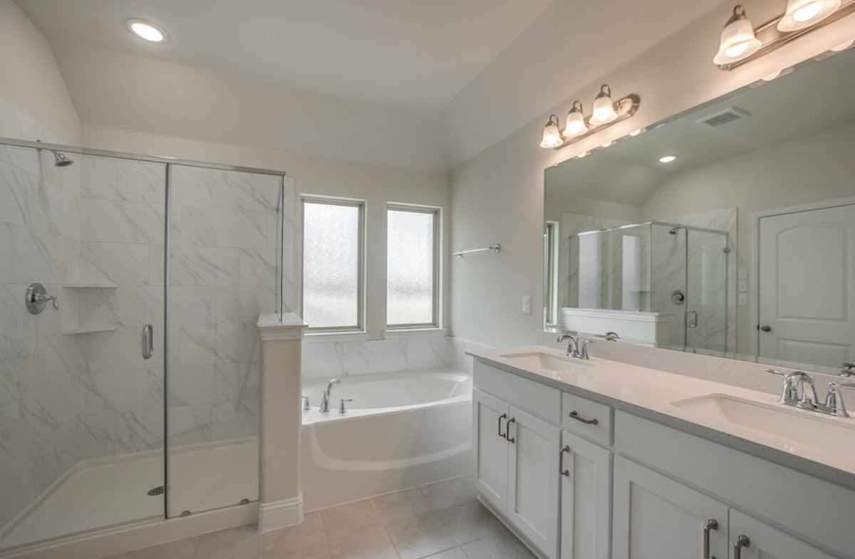 Whitney quick move-in master bathroom with soaking tub and shower