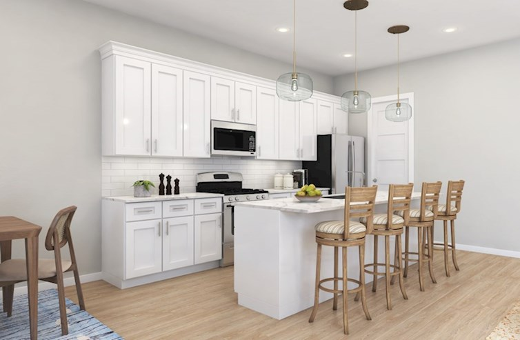 Dogwood open kitchen with white cabinets and wood floors