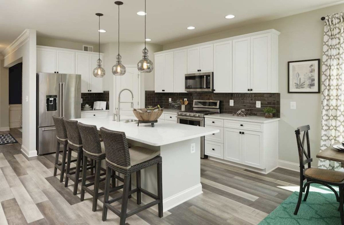 The Estuary Newport Open kitchen featuring granite countertops