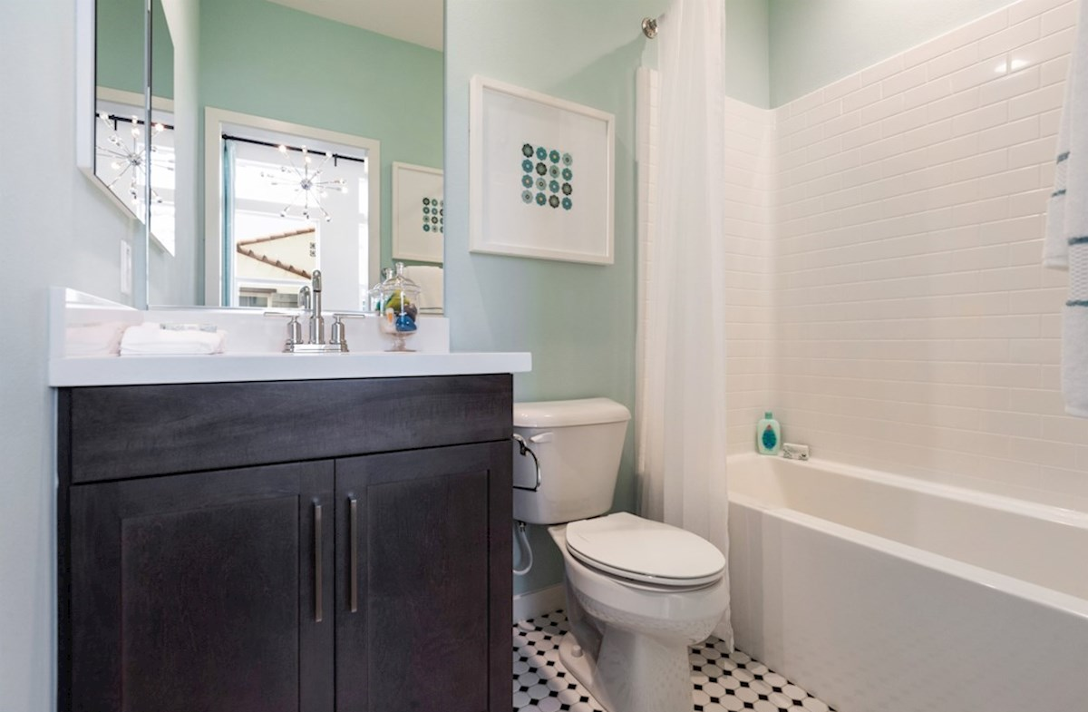 Orchid quick move-in Located in the bathroom, the linen closet adds storage exactly where you need it