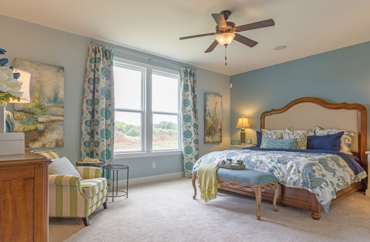 spacious main level master bedroom in soft blues