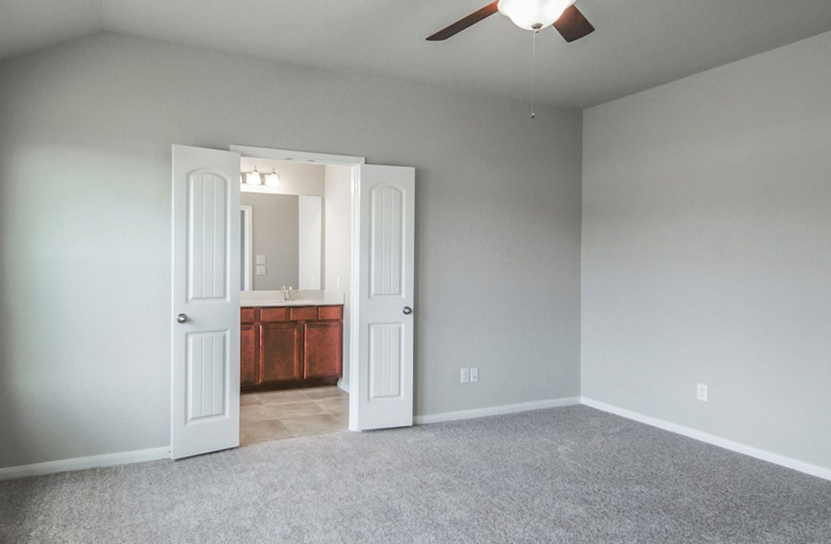 Hickory quick move-in master bedroom with carpet flooring