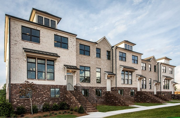 3-story townhomes with brick exterior