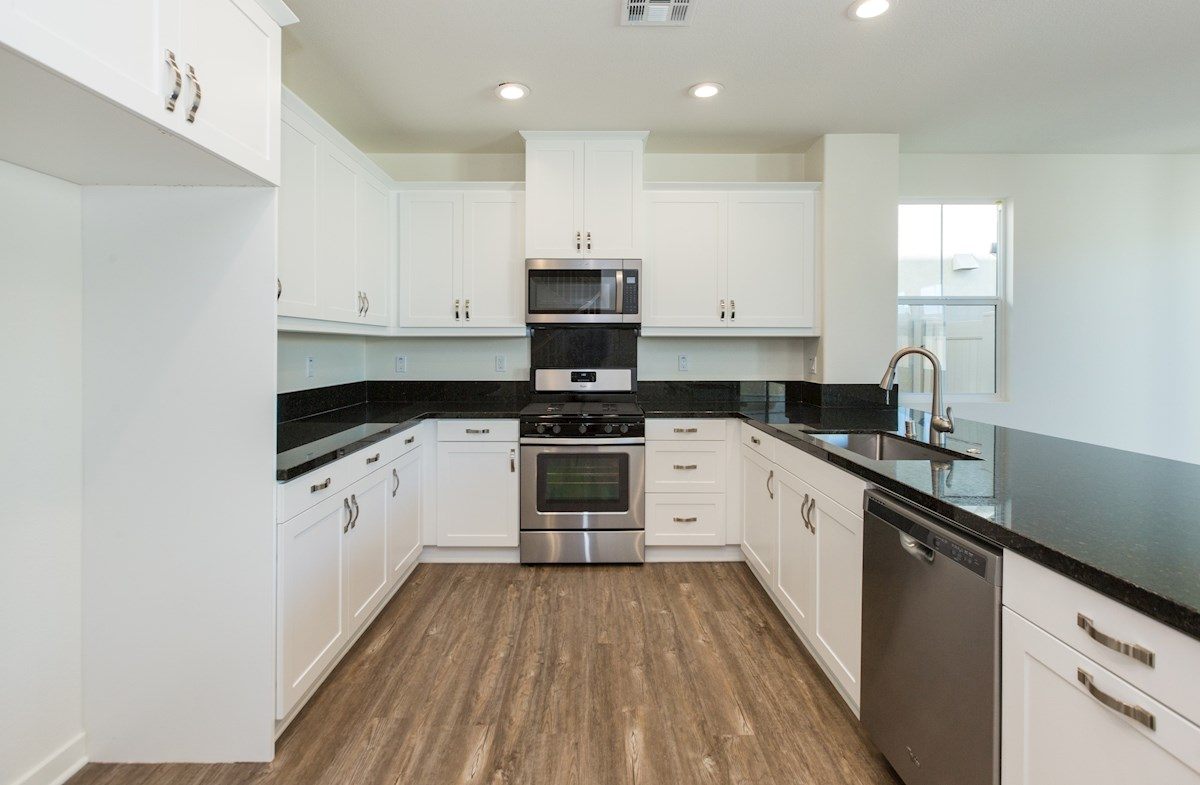 Suncup quick move-in kitchen with plank floors