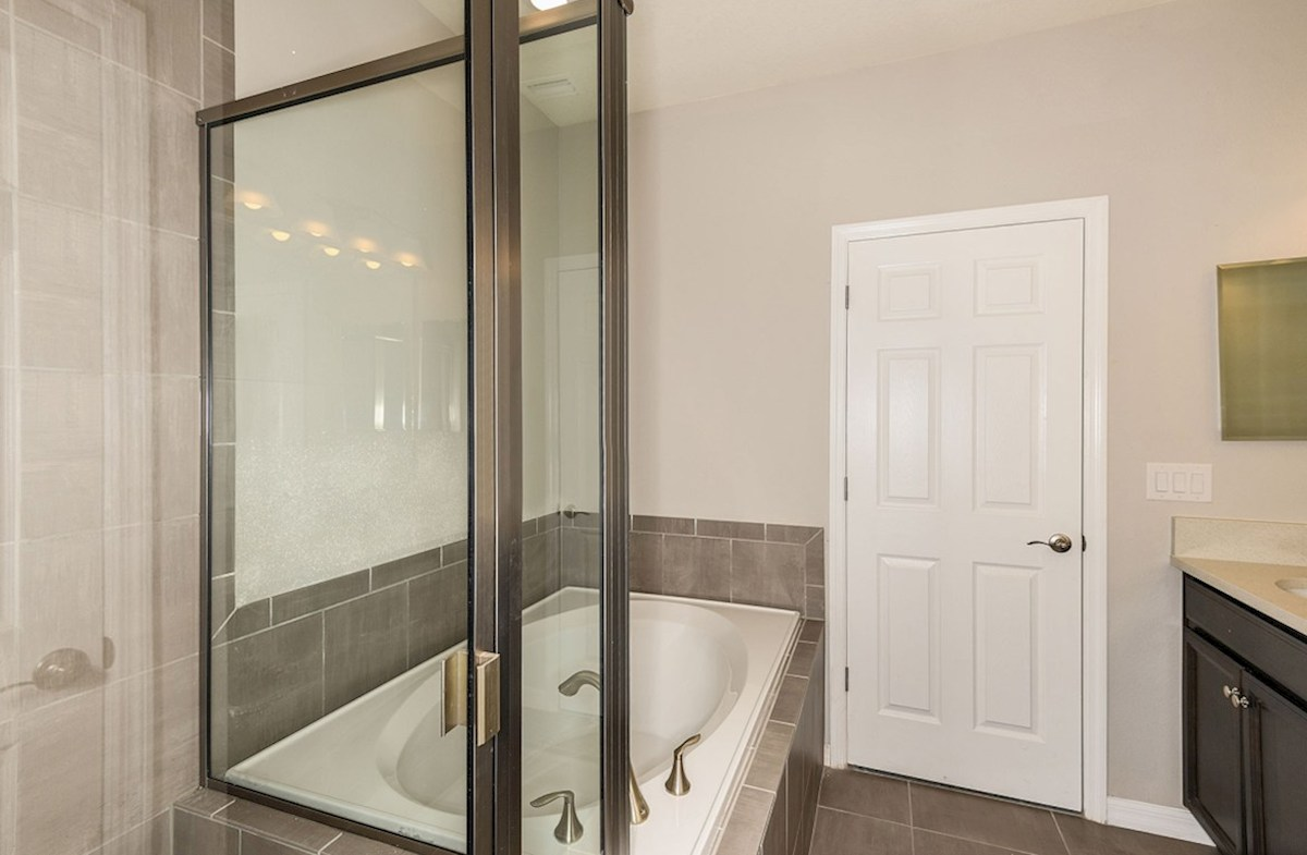 Siesta Key quick move-in Master Bathroom with tub and walk-in shower