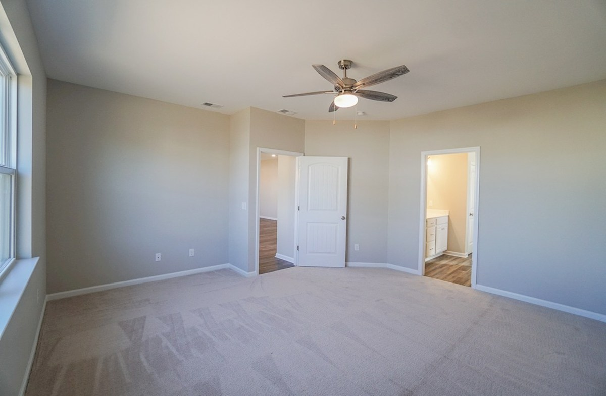 Summerton quick move-in master bedroom features carpet