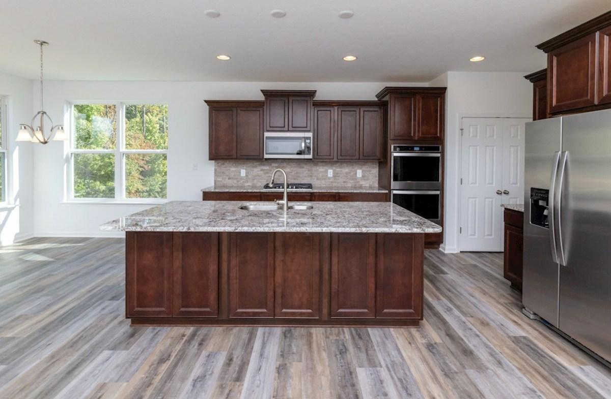 Hampshire Crossroads Collection Greenwich open kitchen with stainless steel appliances