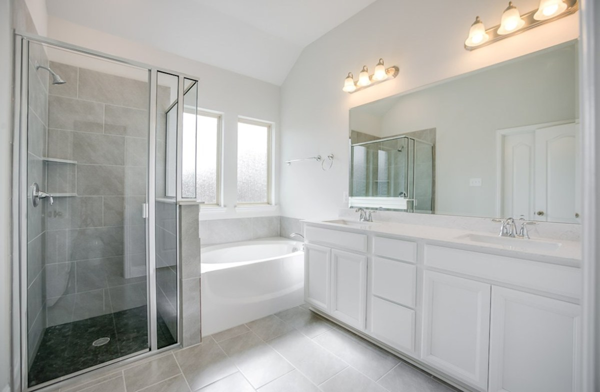 Lakes of Prosper Covington Covington master bathroom with separate tub and shower