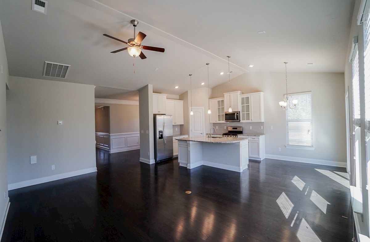 Savannah quick move-in great room features vaulted ceilings and hardwoods