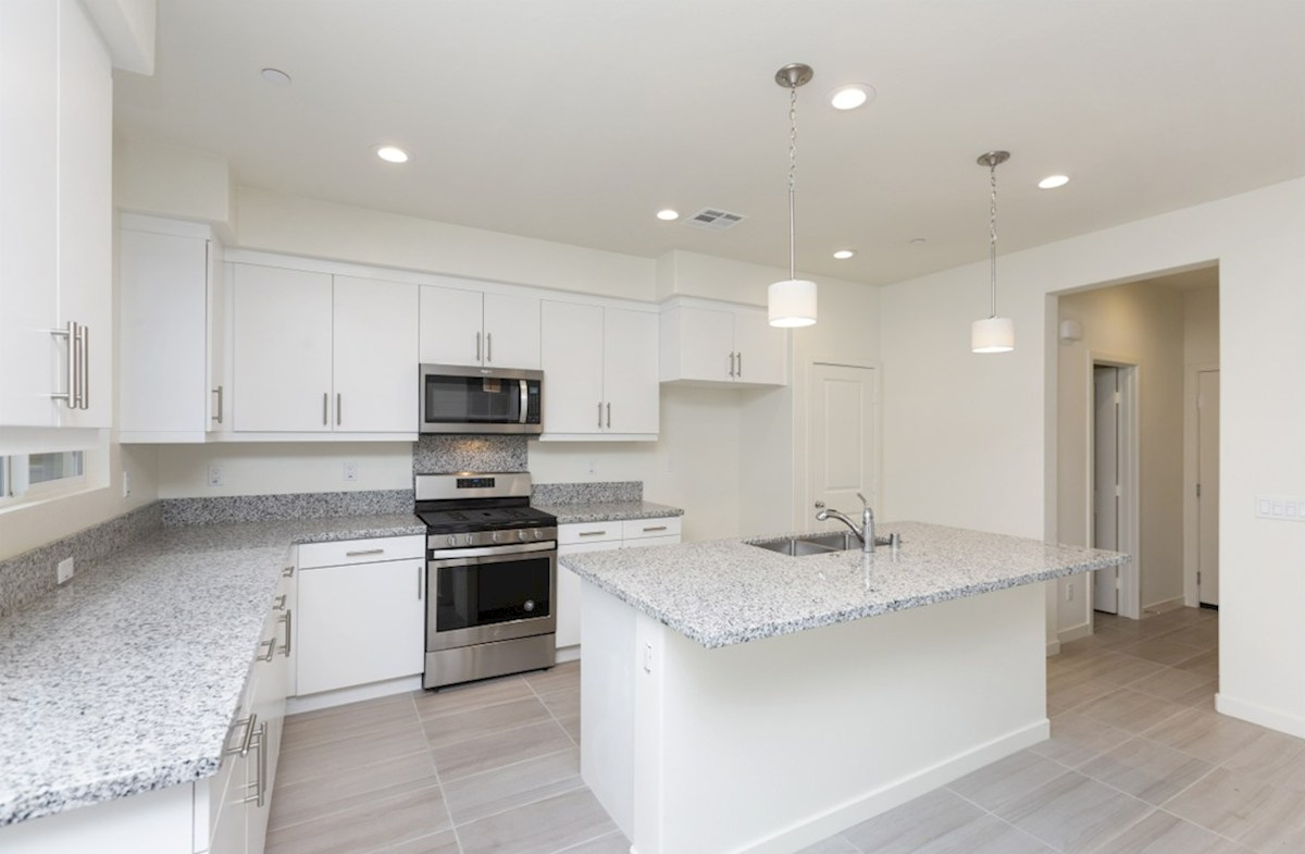 Mission Lane Pinyon Gourmet kitchen boasts an oversized island, stainless steel appliances, and stunning granite countertops