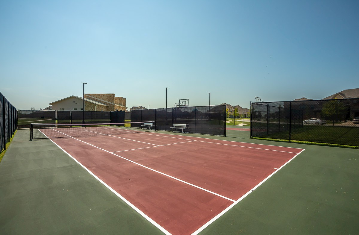 community tennis courts with bench