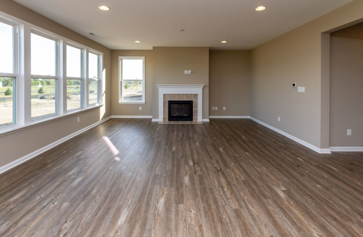 Shelby quick move-in Great room features a gas fireplace