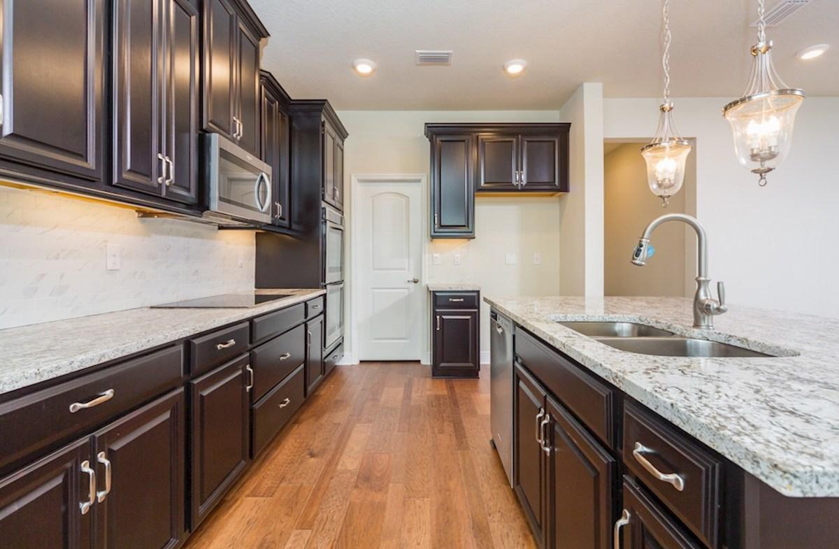 Sea Breeze quick move-in Kitchen features espresso cabinets and granite counters